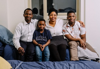 The Adewumi family: Tani and his brother, Austin, and their parents, Kayode and Oluwatoyin