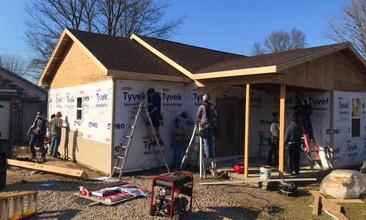 Volunteers help rebuild John Holaday's house