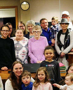 Linda Herring surrounded by her foster children