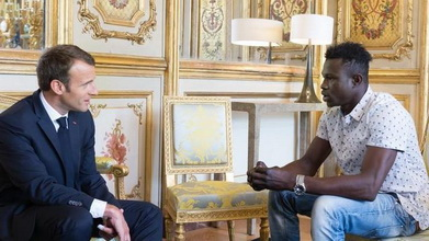 French President Macron and Mamoudou Gassama