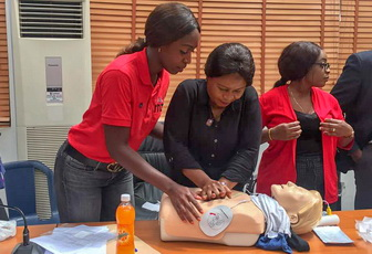 Patricia Sulaiman teaching CPR and AED techniques