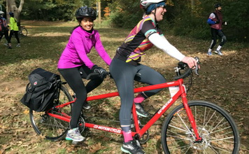 Qudsiya Naqui and Shira Gordon pair up on a tandem bicycle